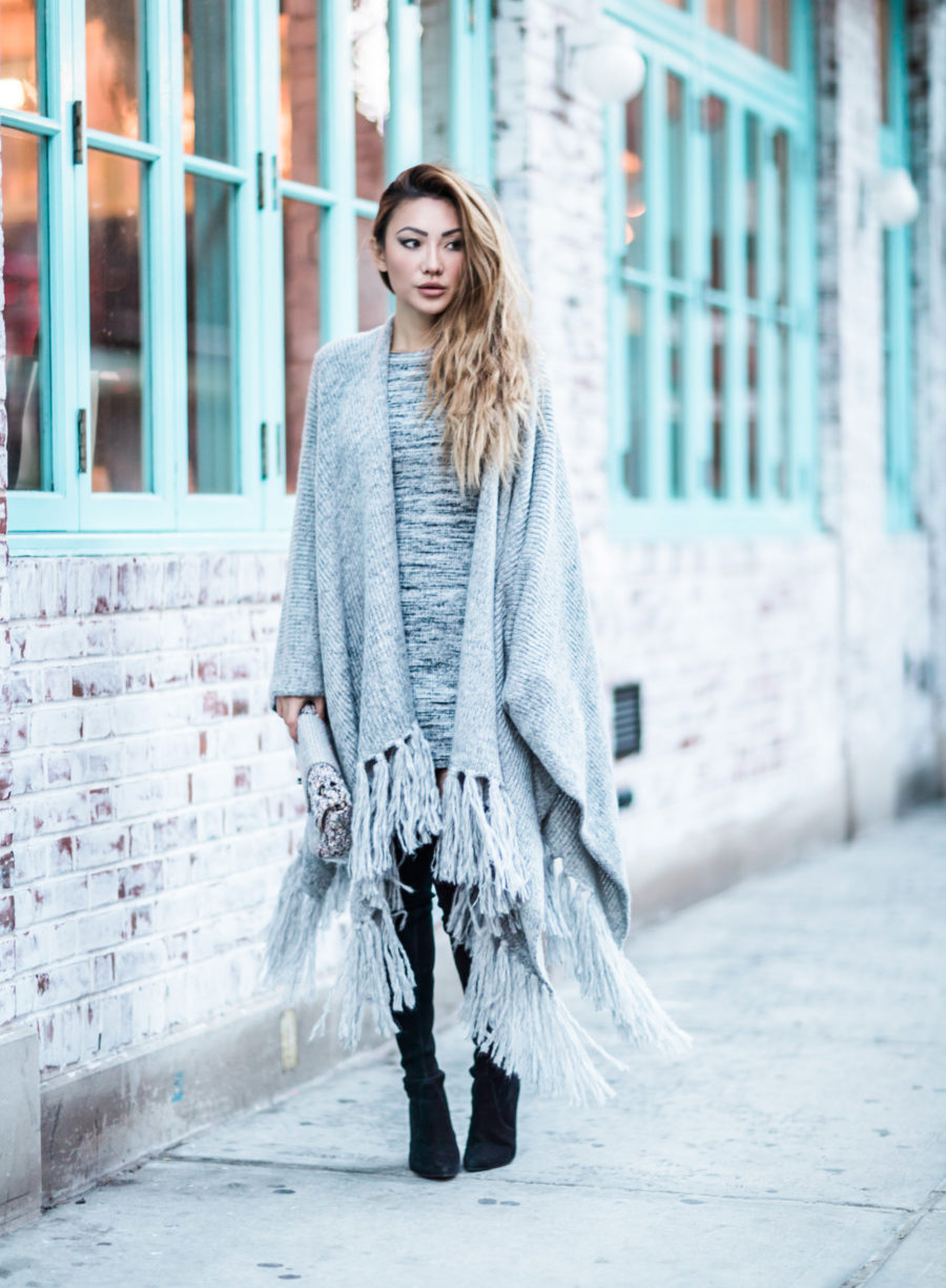fashion blogger jessica wang wears a sweater dress with stuart weitzman over the knee boots and a fringe poncho // Notjessfashion.com