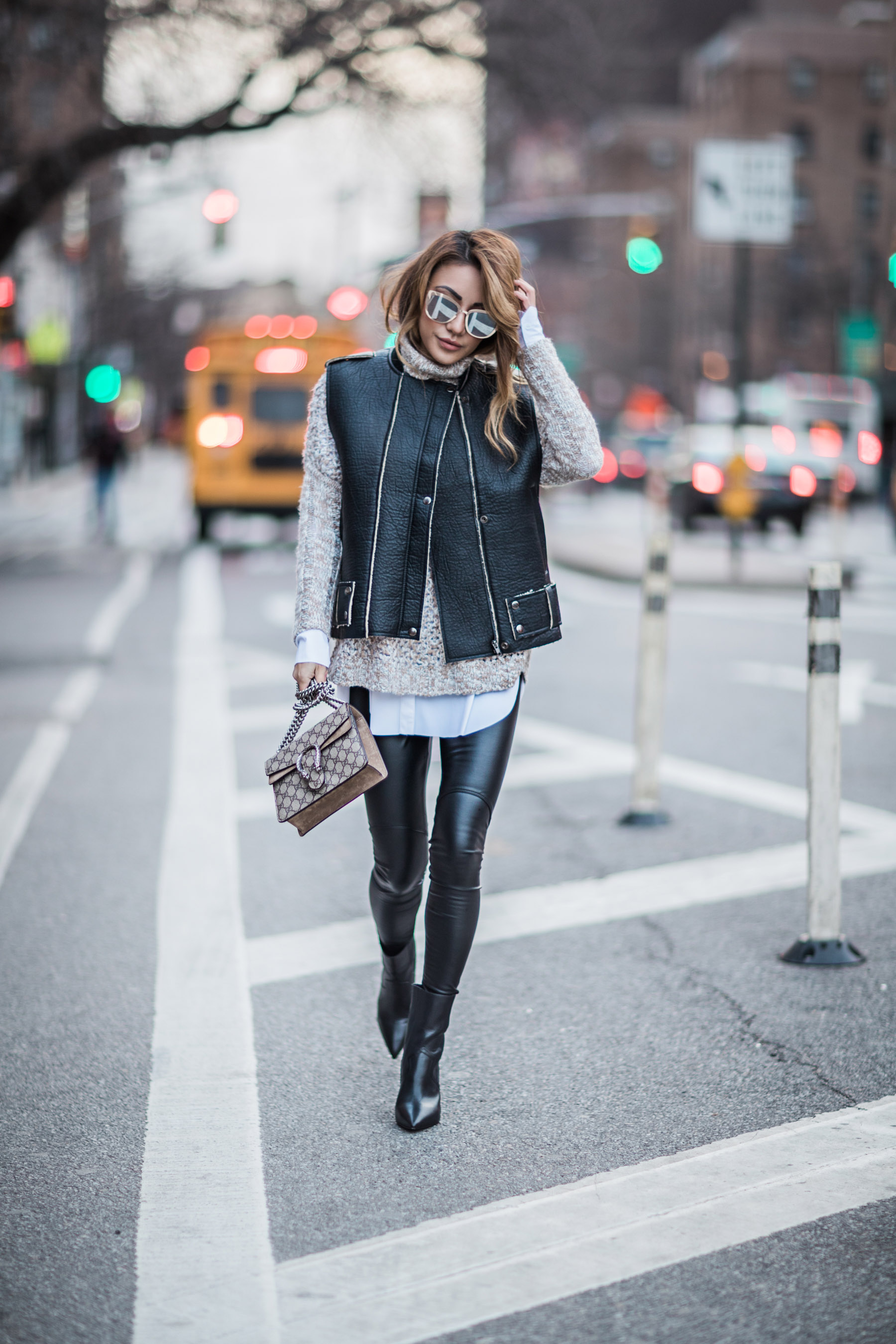 Essential Photography Tips for New Bloggers - Leather vest with leather leggings // NotJessFashion.com // layered look, winter outfit, winter layers, cozy winter look, mirrored sunglasses, gucci dionysus mini, leather leggings outfit, all saints boots, leather vest, how to layer for fall, jessica wang, new york fashion blogger, asian blogger, fashion blogger street style, street style fashion