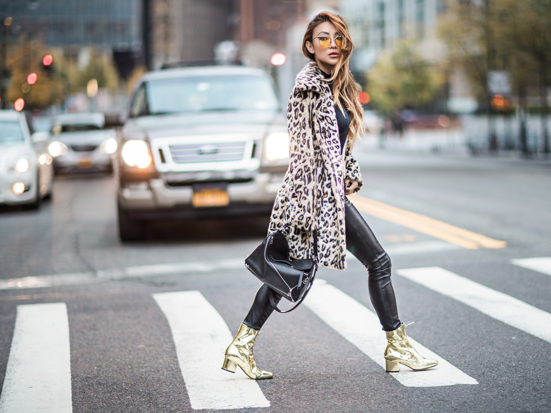 Essential Photography Tips for New Bloggers - Leopard coat, Leather Pants, and Gold Boots // Notjessfashion.com // yellow aviator sunglasses, winter style, winter outfit, layered outfit, street style fashion, fashion blogger street style, new york fashion blogger, faux fur leopard coat, faux fur coat, asian blogger, jessica wang, edgy style