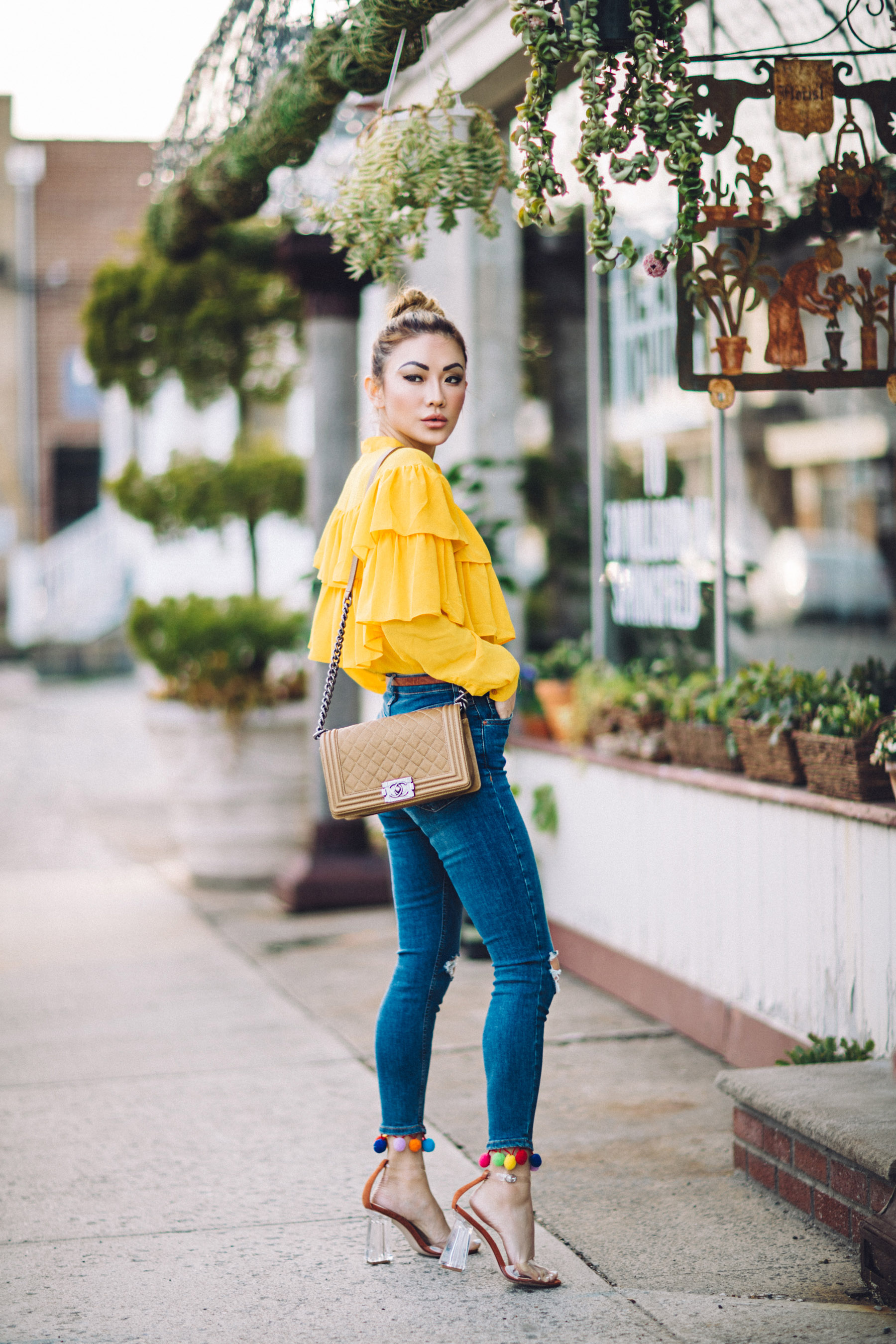 7 Posing Tips for Bloggers - Yellow ruffle top, jeans with pom pom hem // Notjessfashion.com
