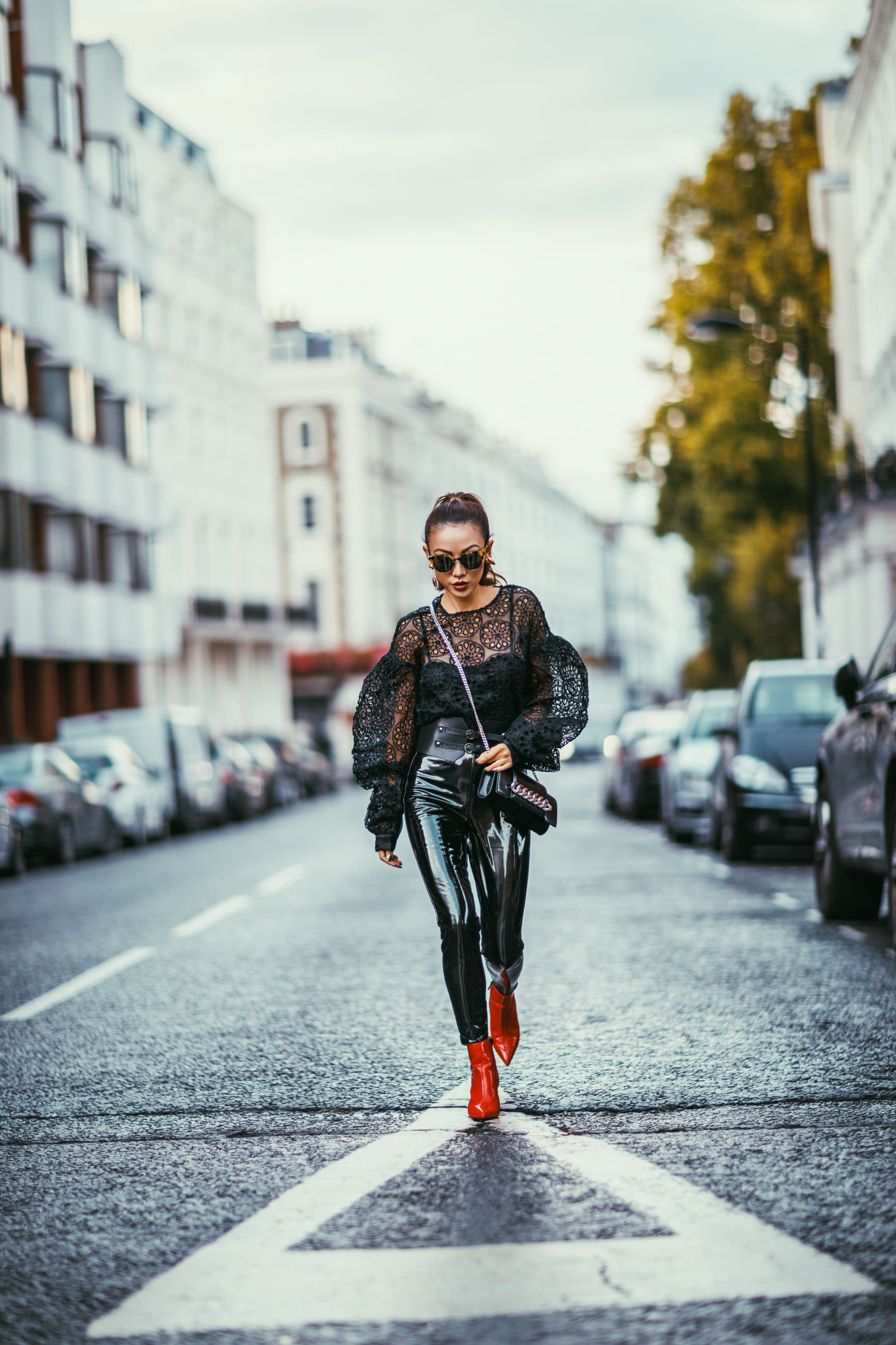 Ultimate Camera Guide for Bloggers - Shooting with a Canon 85mm 1.2 // NotJessFashion.com // Street style patent leather pants with red boots and lace top