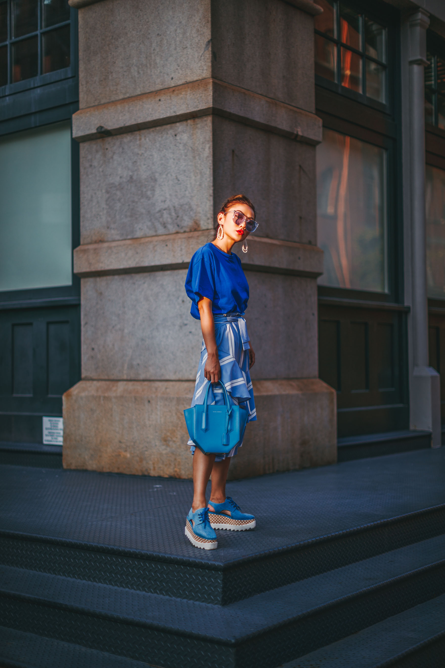 Elevate your everyday outfit with statement color mini bags - Blue Monochromatic Outfit, Edgy Style, Blue Statement Bag // NotJessFashion.com