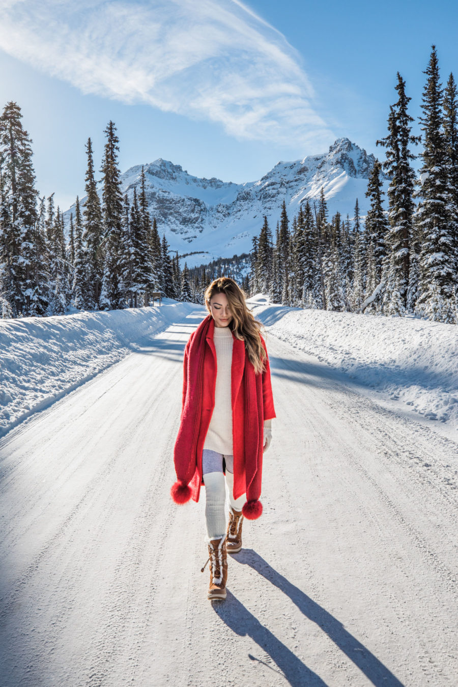 Winter Packing Tips - Red Coat with Pom Pom Scarf and Snow Boots // Notjessfashion.com