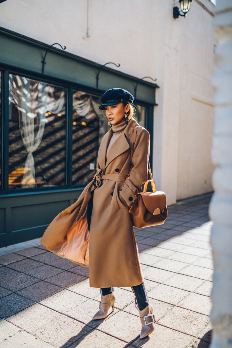 Clothing items worth investing in - Belted Camel Coat with Dark Denim Baker Boy Cap and Satchel // Notjessfashion.com