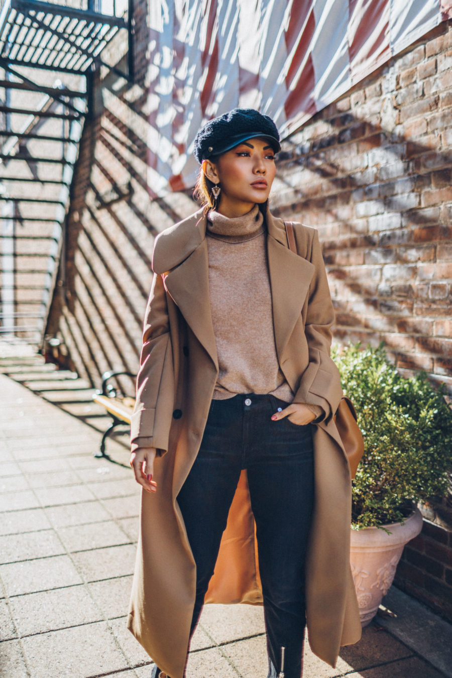 How to Buy an Investment Coat - Belted Camel Coat with Dark Denim Baker Boy Cap and Satchel // Notjessfashion.com