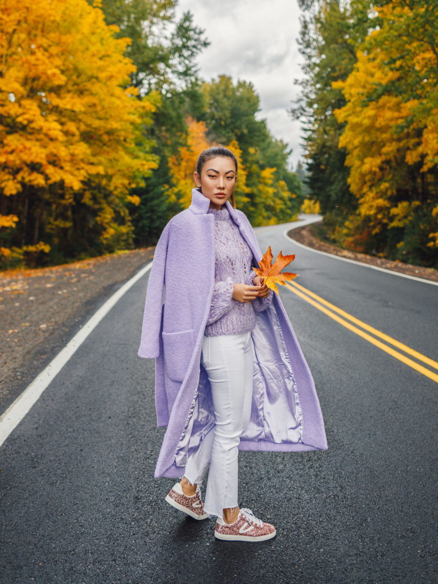 How to Wear 2018's It Color Lavender // Notjessfashion.com // Lavender coat, white cropped flare jeans, cropped flare jeans, glittery sneakers, fall fashion, winter fashion, white and lavender outfit, asian blogger, fashion blogger, new york fashion blogger, how to wear lavender, lavender outfits, fashion blogger street style, jessica wang, cozy outfit, casual fall outfit