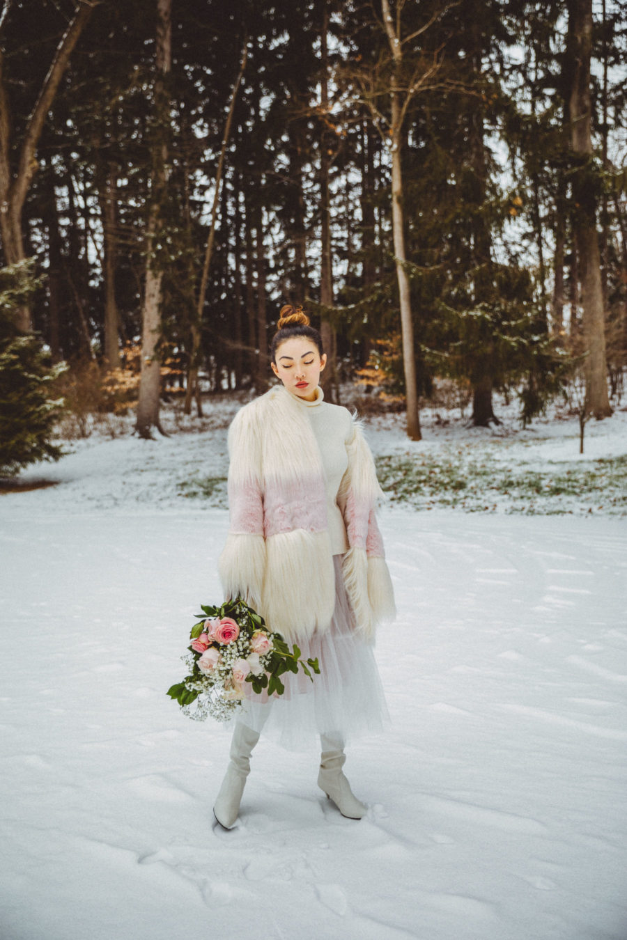 Dressy Winter Outfits - White and Pink Fur Coat with Tulle Skirt and White Sweater // Notjessfashion.com // elegant winter outfit, dressy outfits for the snow, snow outfit, tulle midi skirt, white boots, winter white outfit, asian blogger, new york fashion blogger, winter fashion editorial