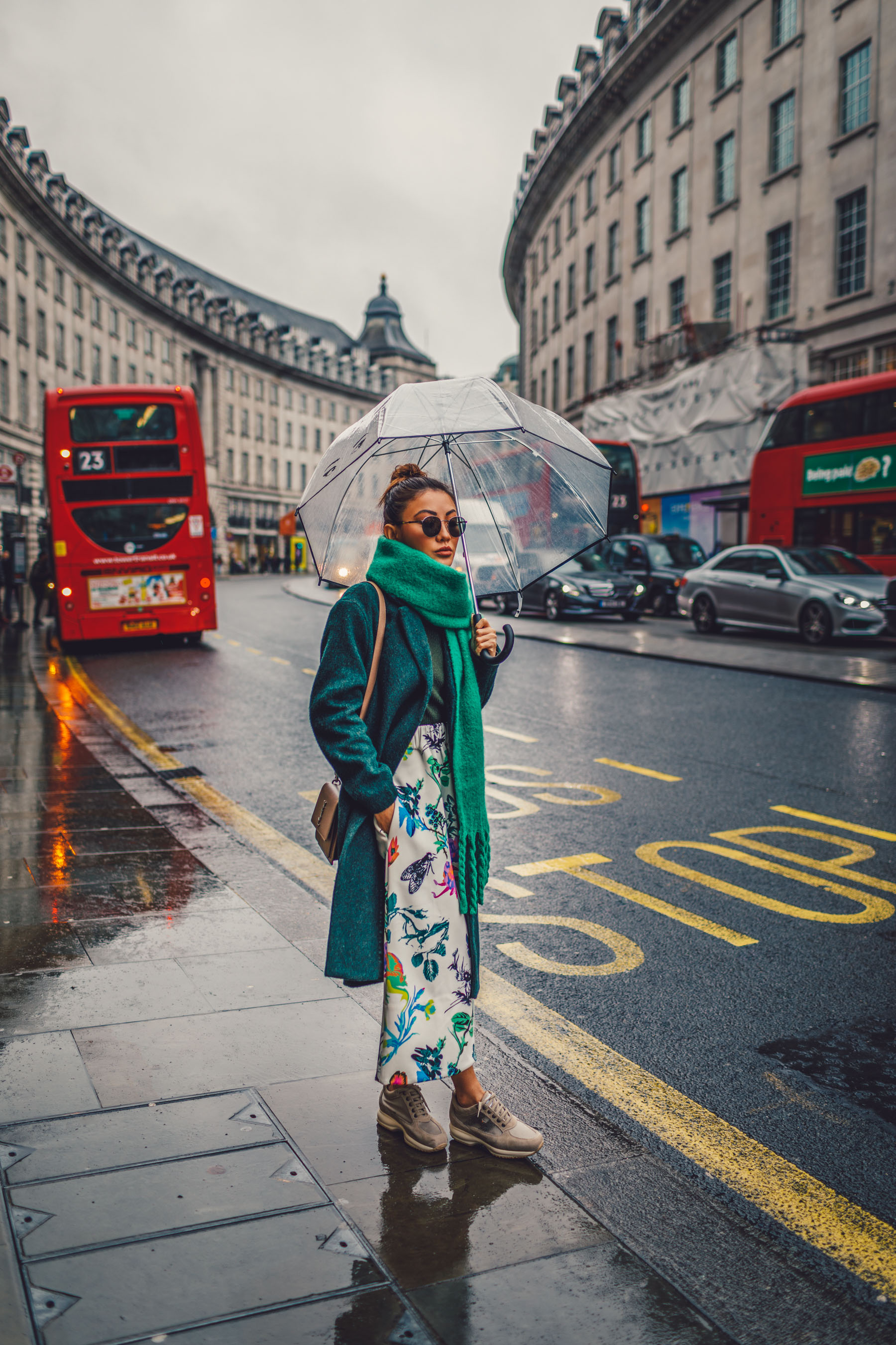 green floral skirt, green coat, dad sneakers, clear umbrella in london, lfw street style // Notjessfashion.com