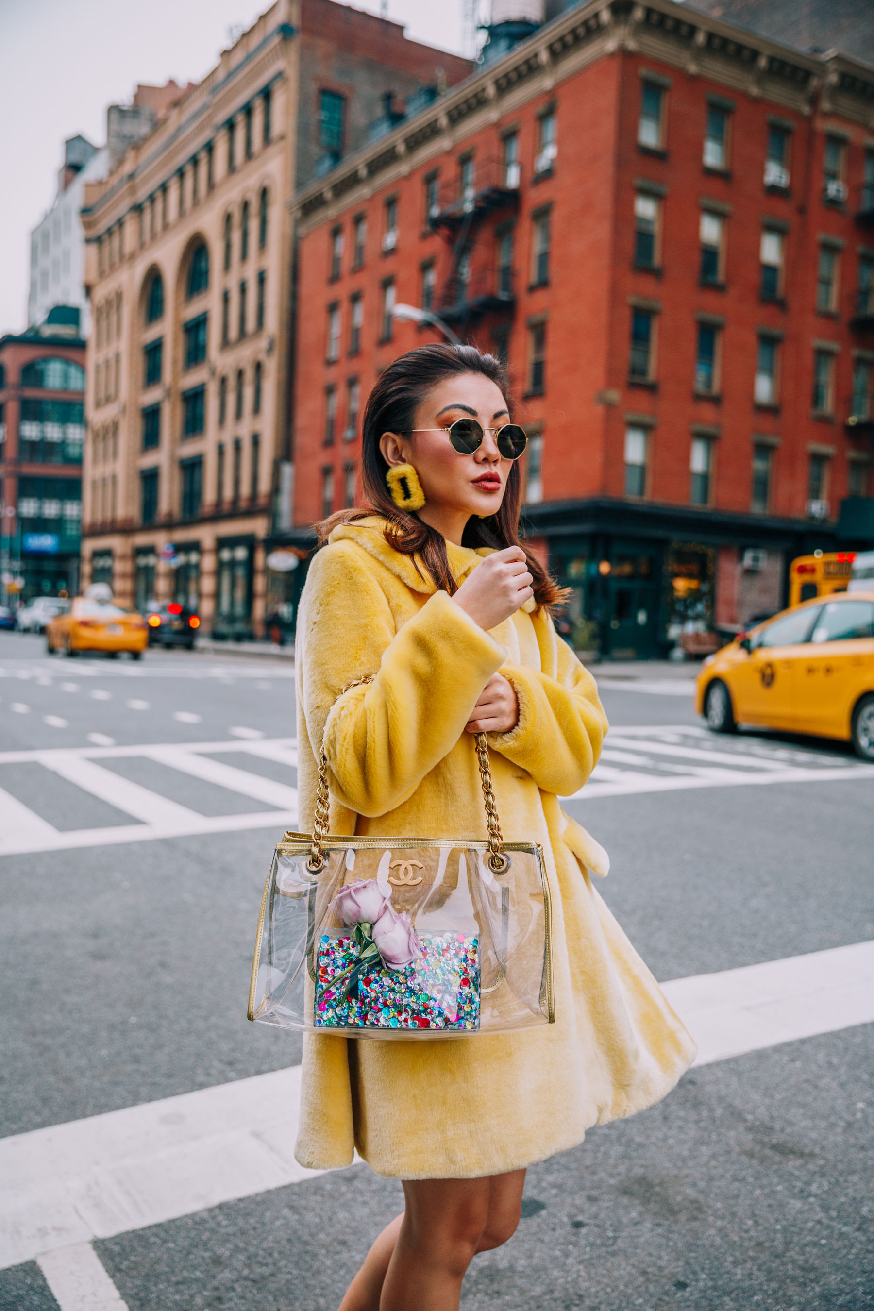 NYFW 2018 Street Style - Shrimps Yellow Fur Coat, Yellow Earrings, and Clear Chanel Bag // Notjessfashion.com