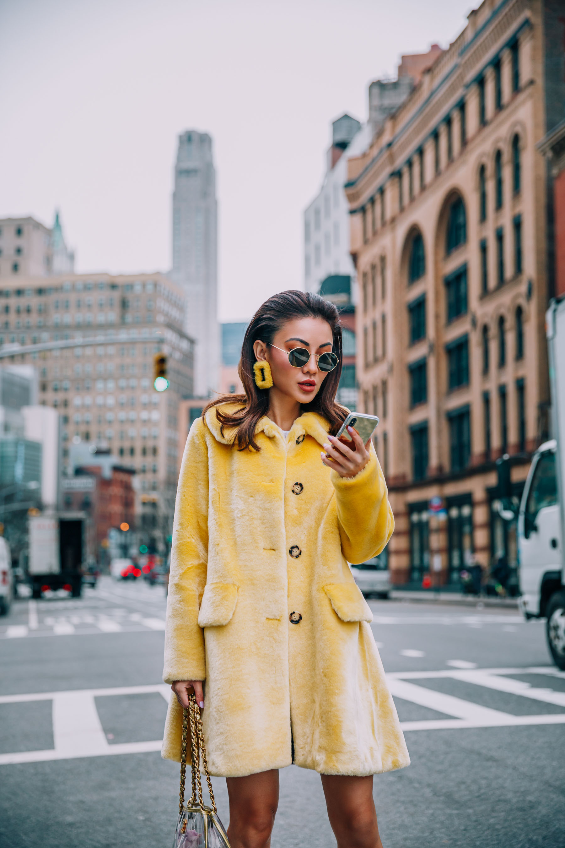 The Best Way to Get Around During NYFW // Notjessfashion.com // Yellow Fur Coat, Yellow Earrings, NYFW Street Style, uber
