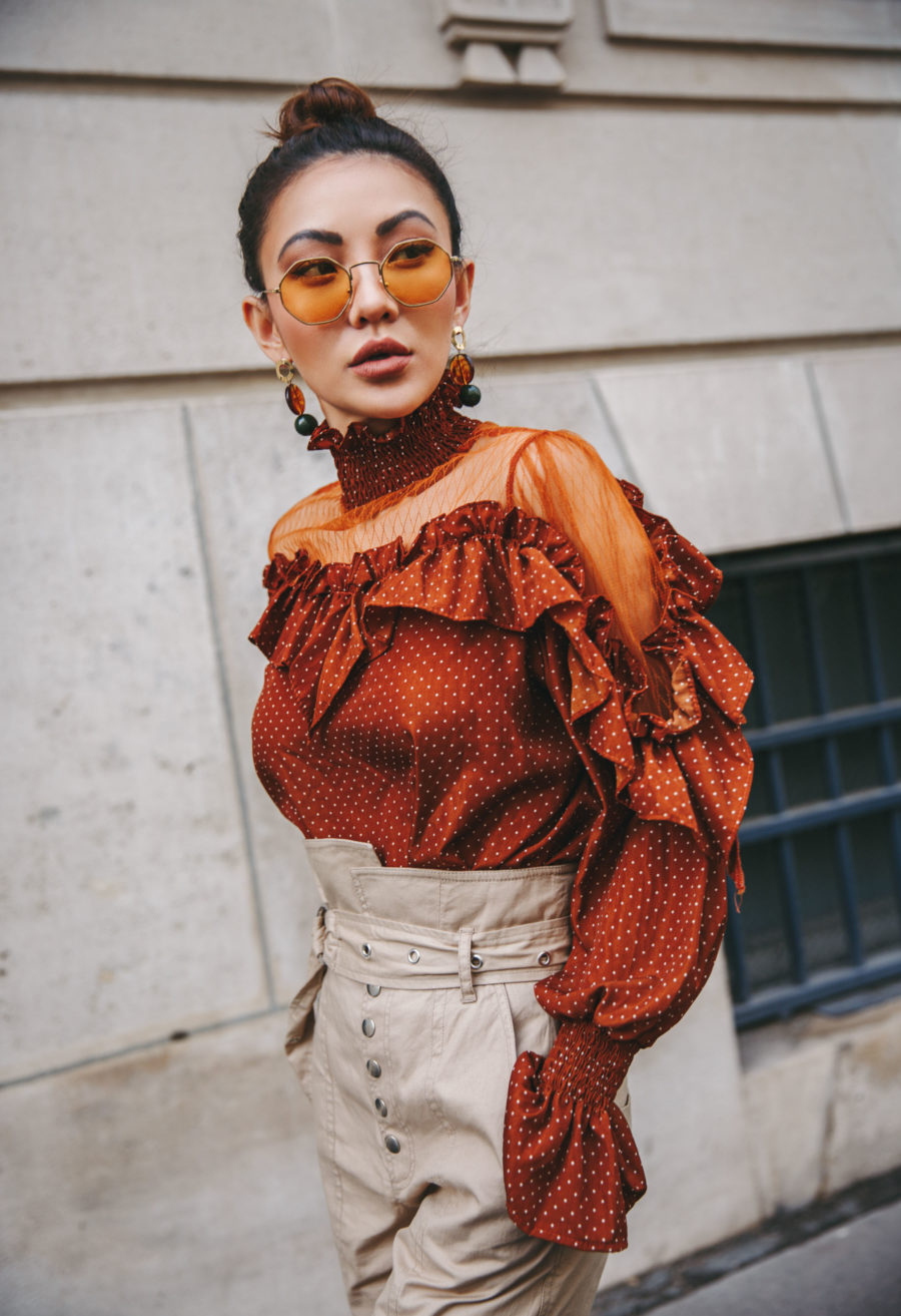 5 Must-Have Sunglasses Every It-Girl Is Wearing Now - Colored Lenses Sunglasses, Orange ruffle top, Spring style, Streetstyle, Highwaisted Beige Pants, Jessica Wang // NotJessFashion.com