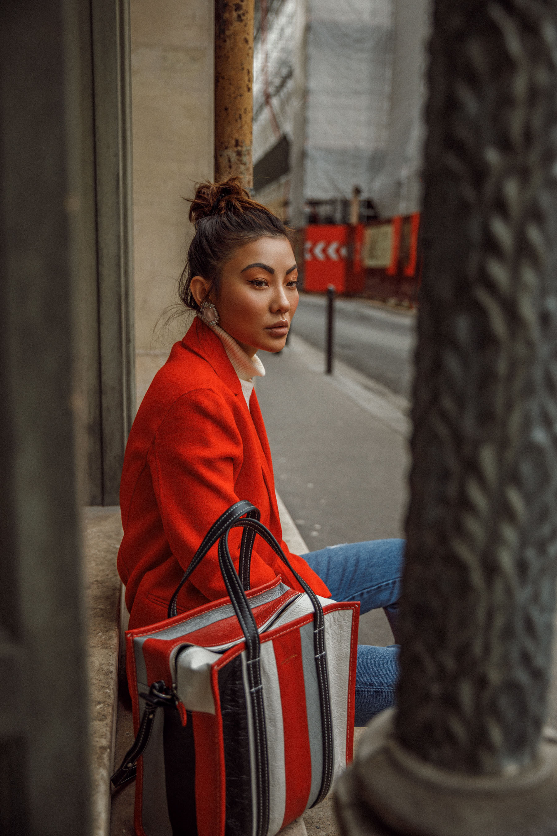 Winter Trends You Can Still Wear In Spring - Bright red coat, cuffed jeans, balenciaga bazar shopper, jessica wang in paris, pfw street style, eiffel tower photo // Notjessfashion.com