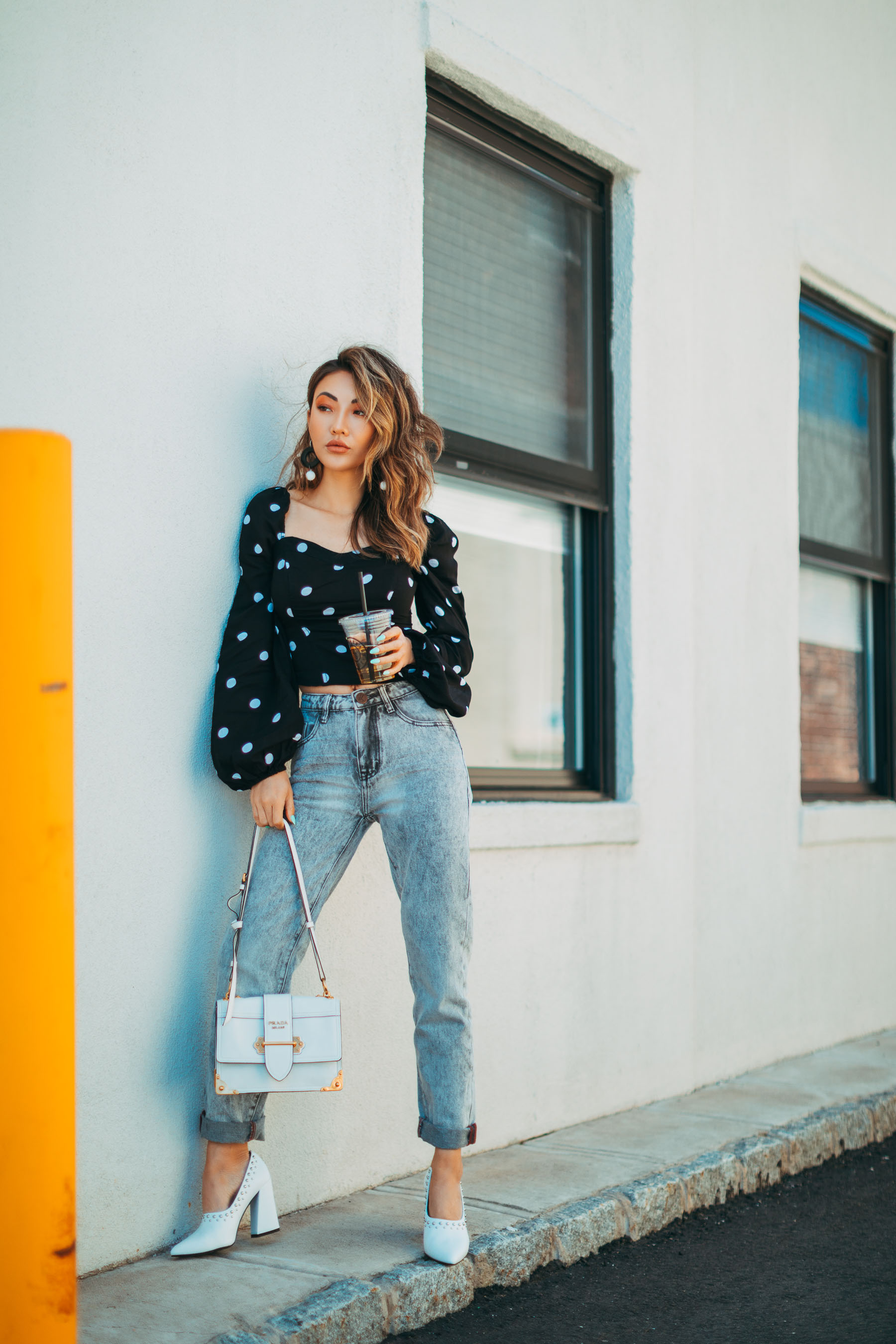 fourth of july outfit guide - polkadot square neckline top with jeans and prada handbag // Notjessfashion.com