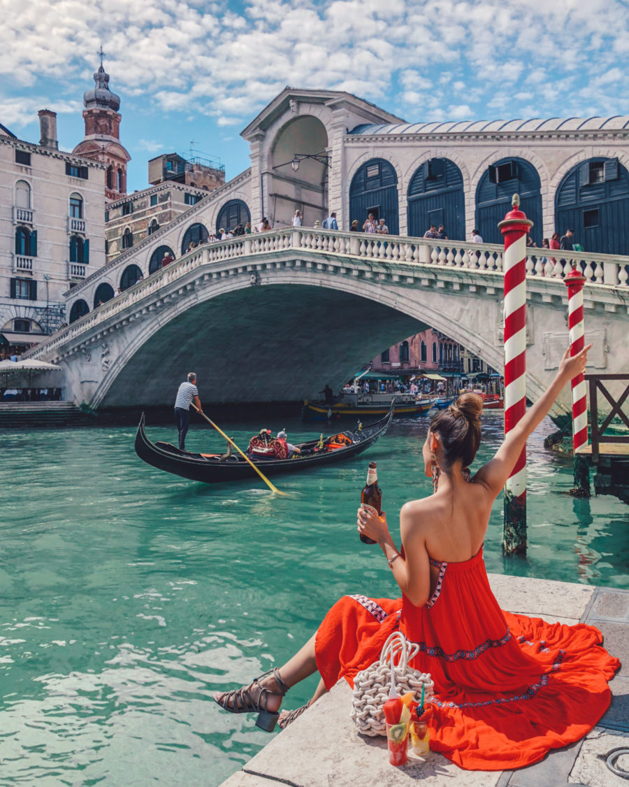 Instagram Outfits in Venice - red sun dress, venice canals, venice bridge, travel blogger, gondola watching in venice, rialto bridge