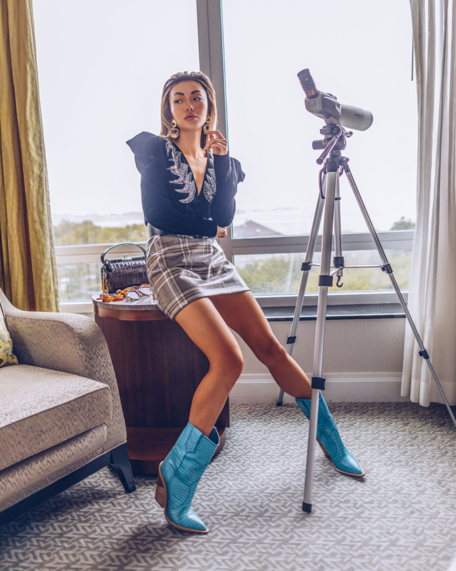 Trends I am ditching in 2020 - cowboy boots, black blouse with puff sleeves, plaid mini skirt // Notjessfashion.com