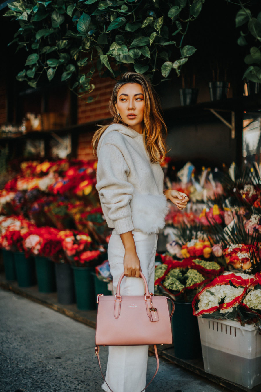 fashion blogger jessica wang shares favorite winter fashion brands wearing Tibi Hoodie with DL1961 Jeans and Coach x Selena Gomez tote bag // Notjessfashion.com
