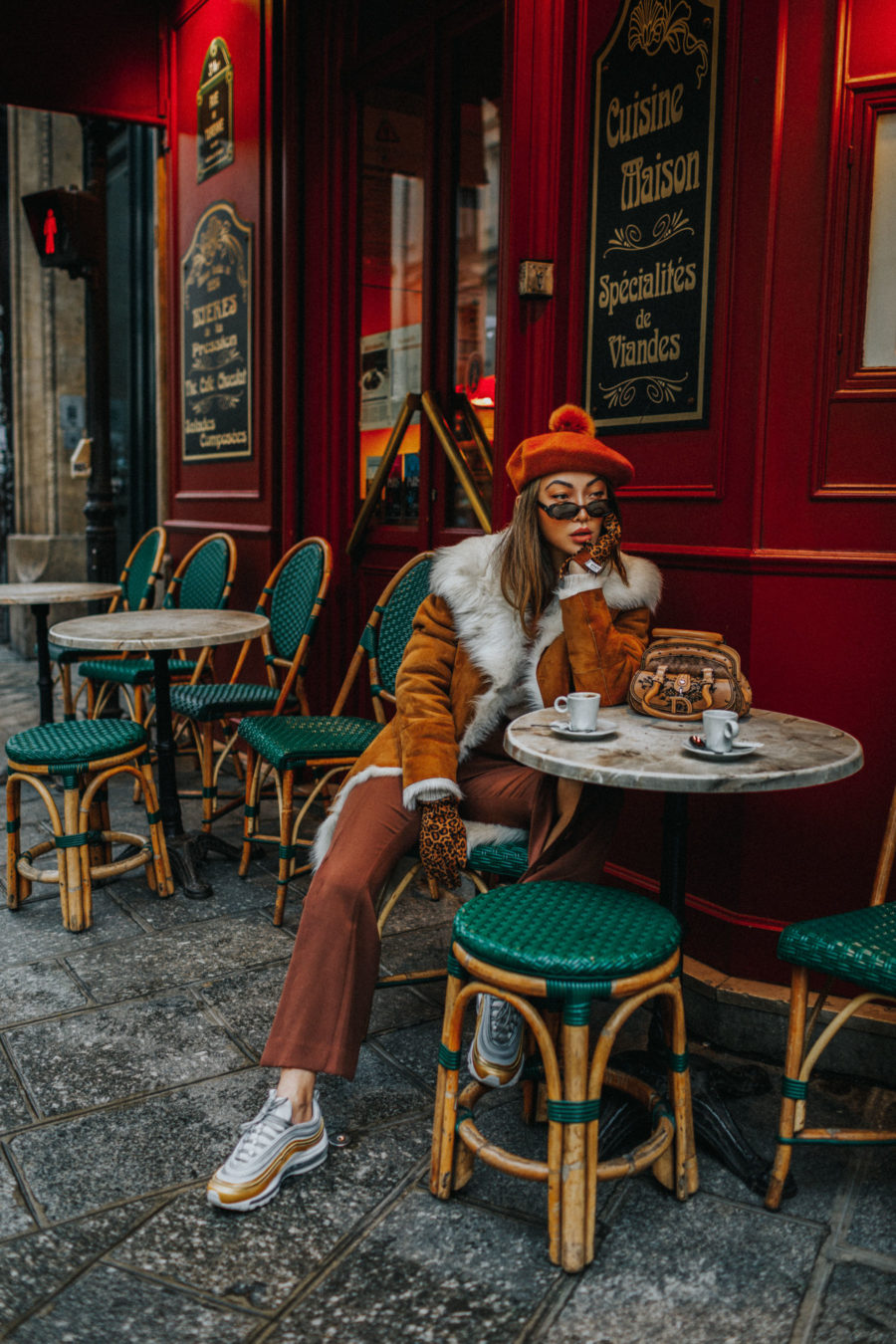 Winter Instagram Outfits - french cafe in the winter, faux fur shearling jacket, pompom beret // Notjessfashion.com