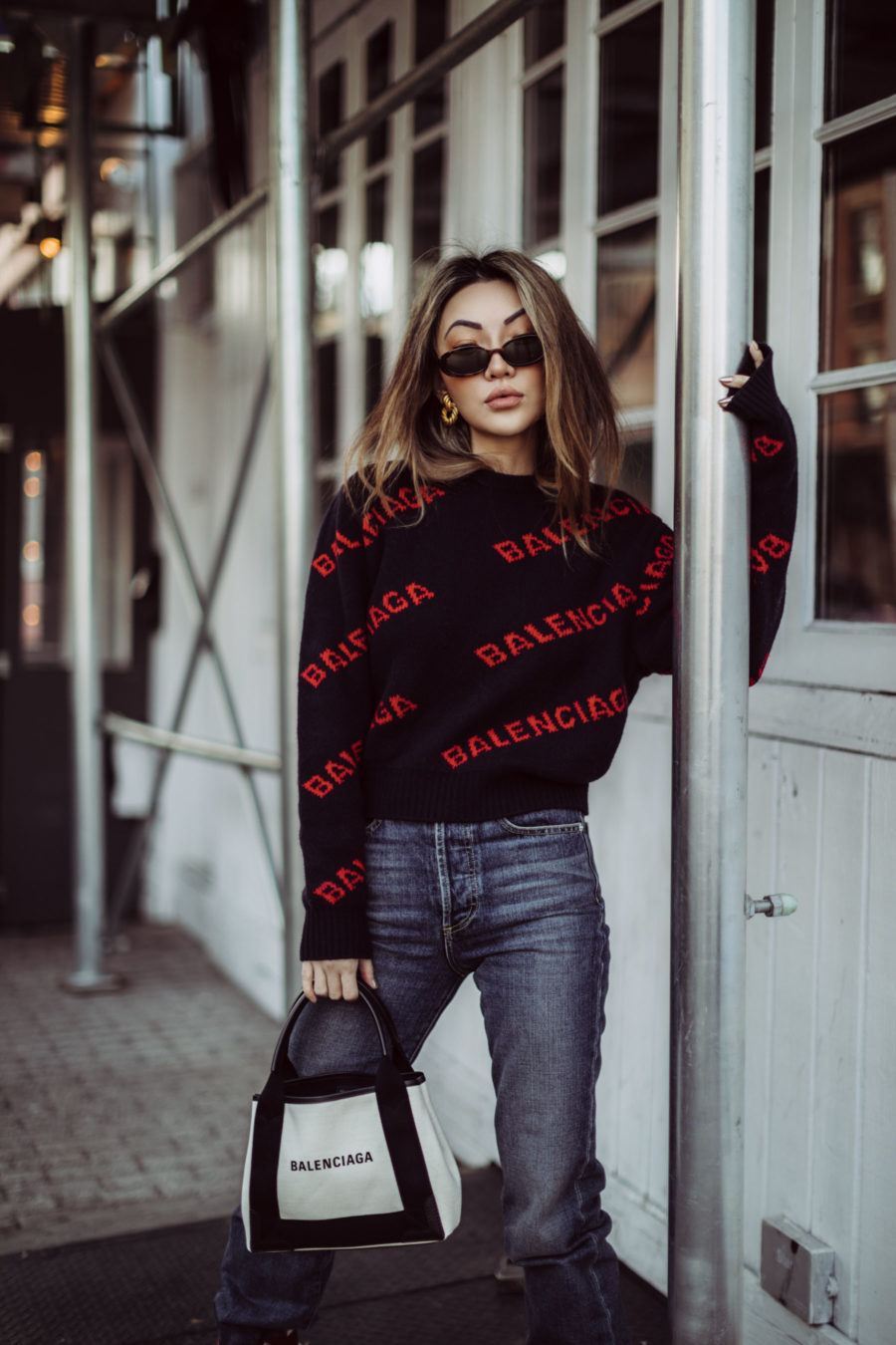 Best outfits for in-between weather - Balenciaga Logo Sweater, Balenciaga Tote, Dakar Boots, sweater and boots outfit // Notjessfashion.com