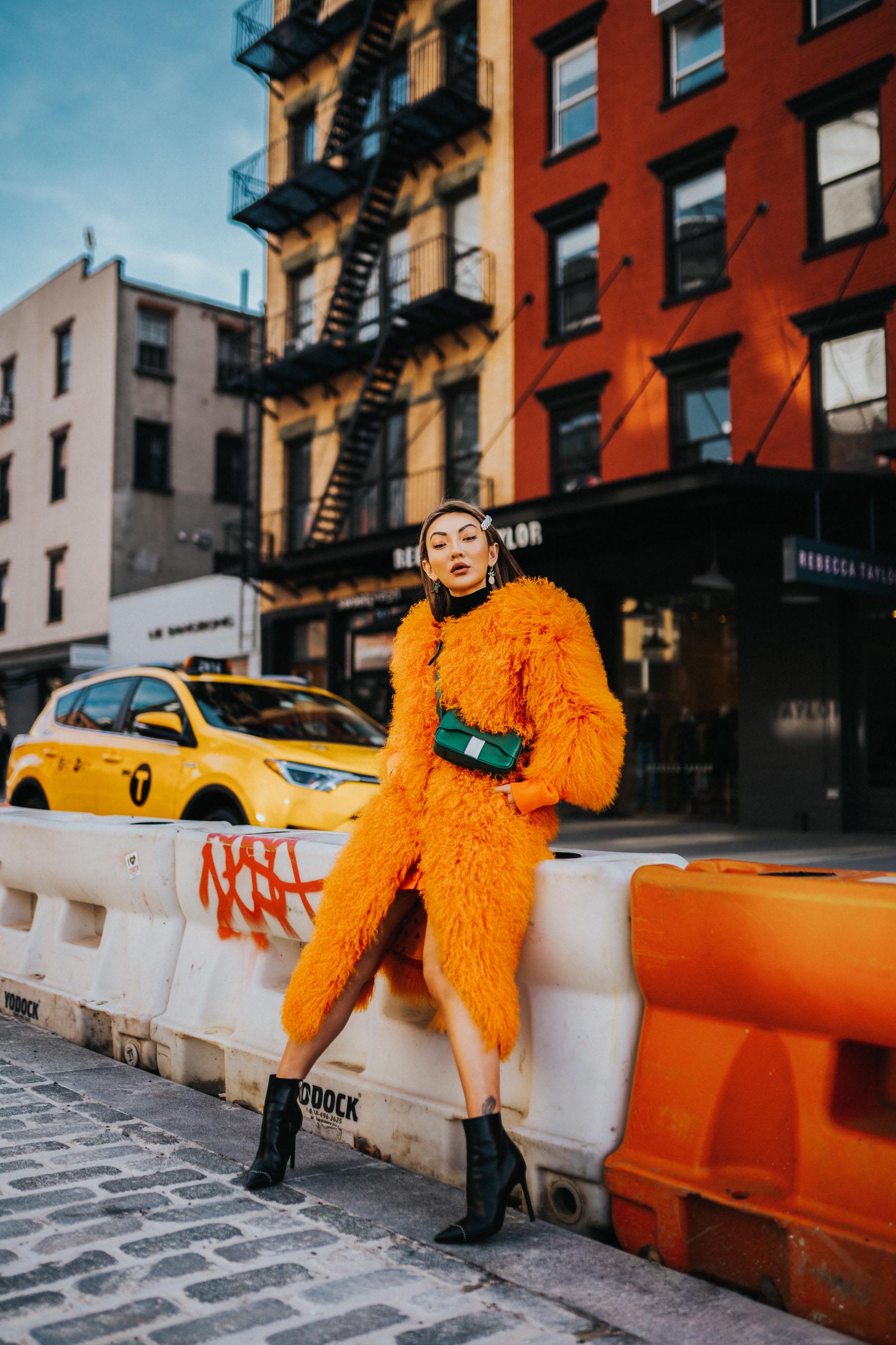 NYFW, How to wear a barrette, orange coat, black boots, green purse, pearl barrette // Notjessfashion.com