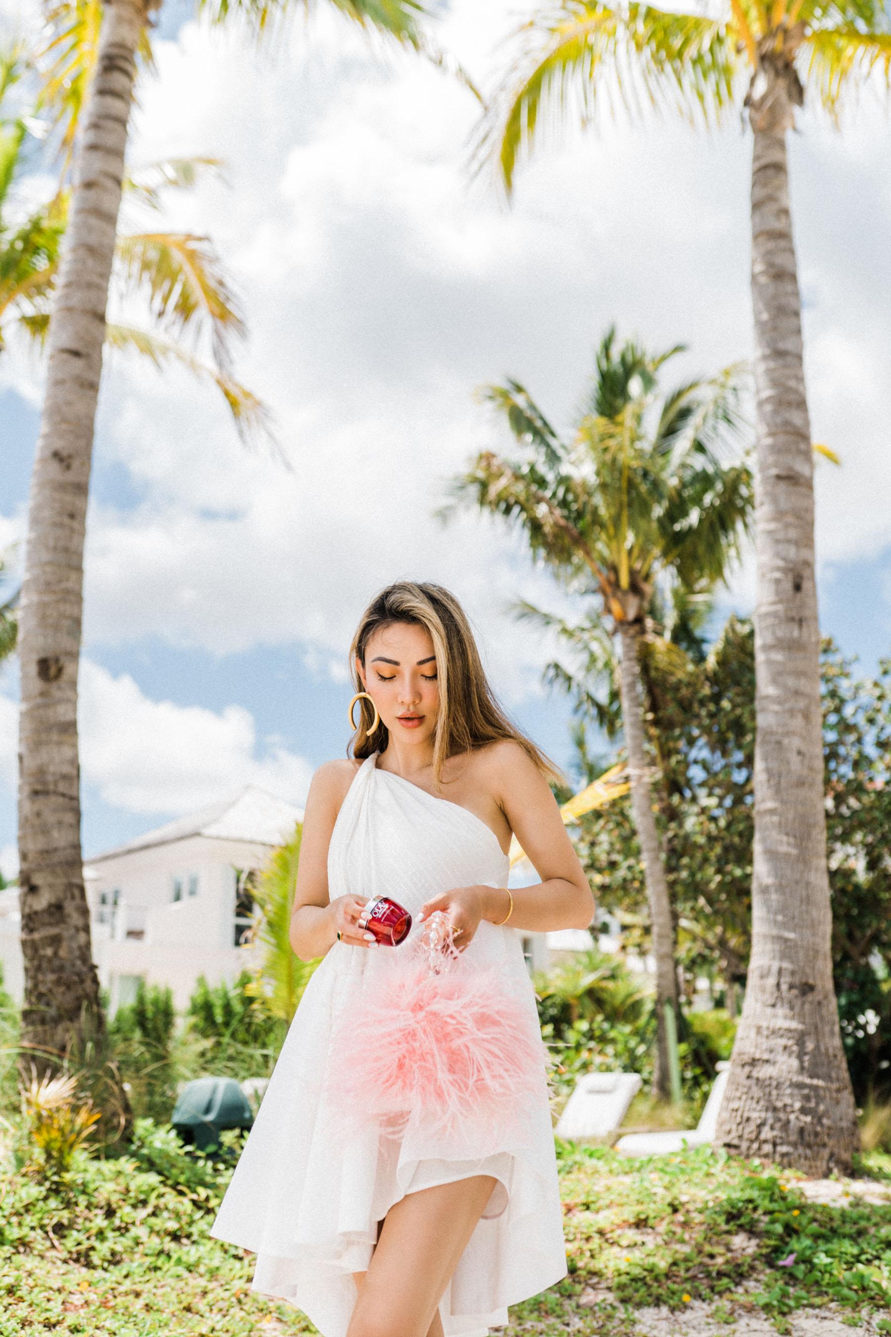 white one shoulder dress, pink fluffy handbag, hoop earrings, essential moisturizer for fresh summer skin, Olay regenerist // Notjessfashion.com