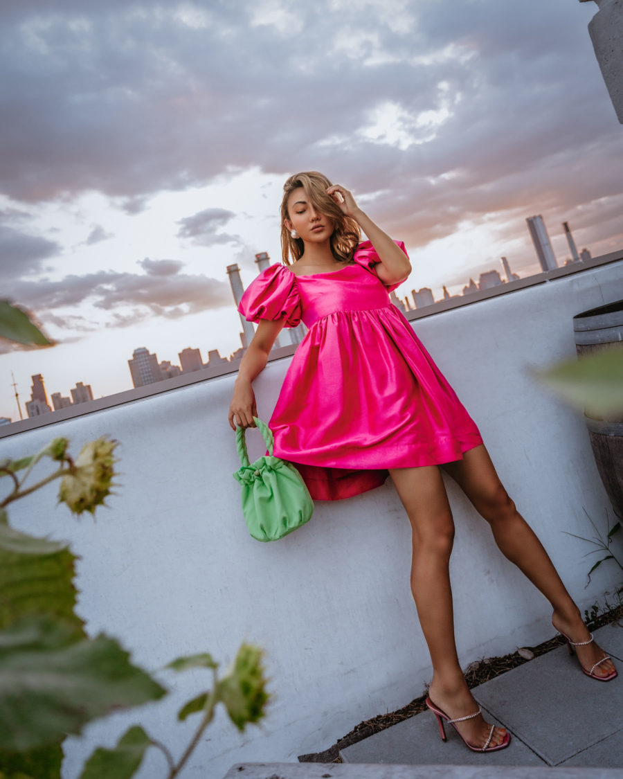 resort wear trends of 2020 featuring fuchsia mini dress with strappy heels and green staud bag // Notjessfashion.com