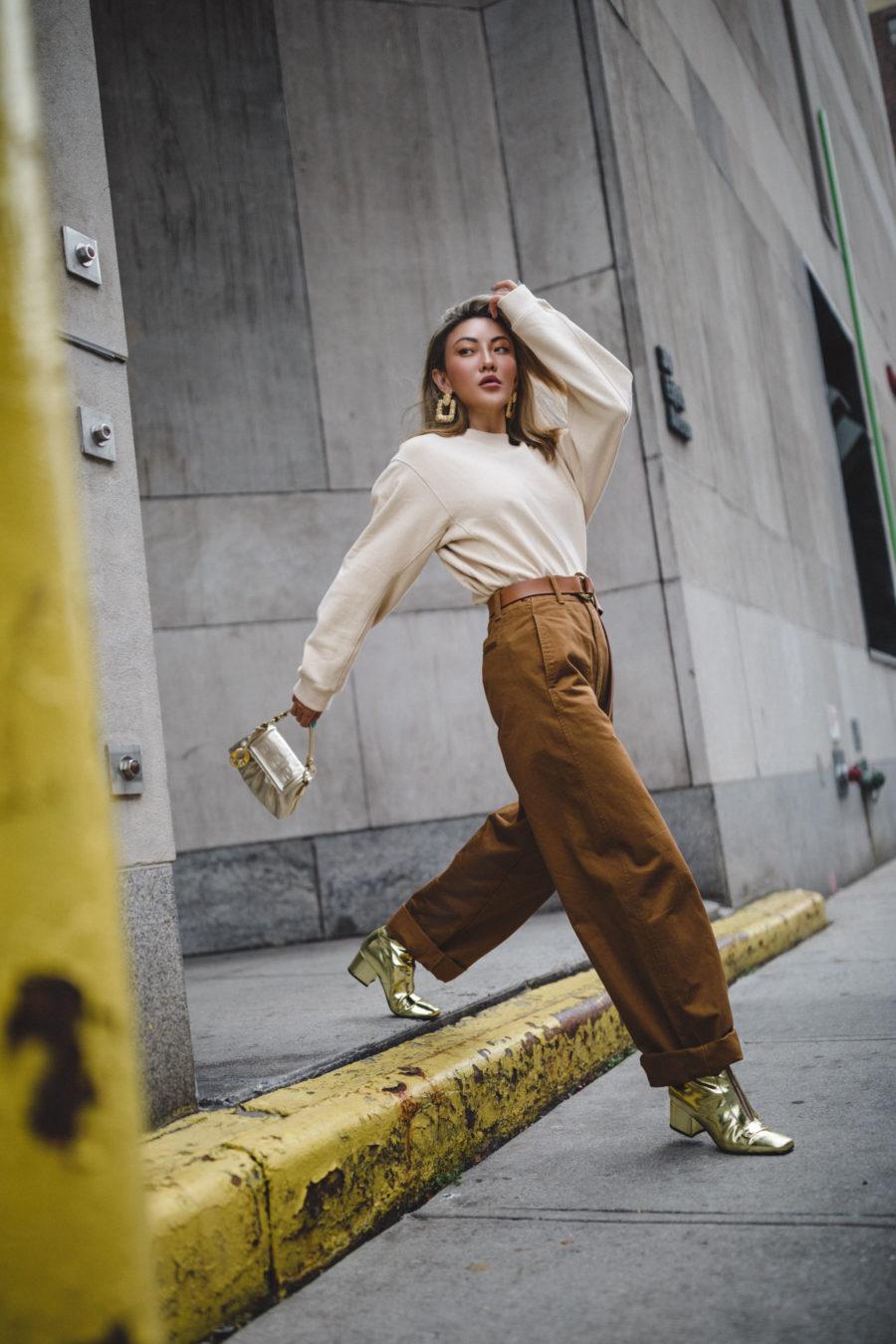 Trends I am ditching in 2020 - pull over sweater, utility pants, mini fendi handbag, metallic boots // Notjessfashion.com