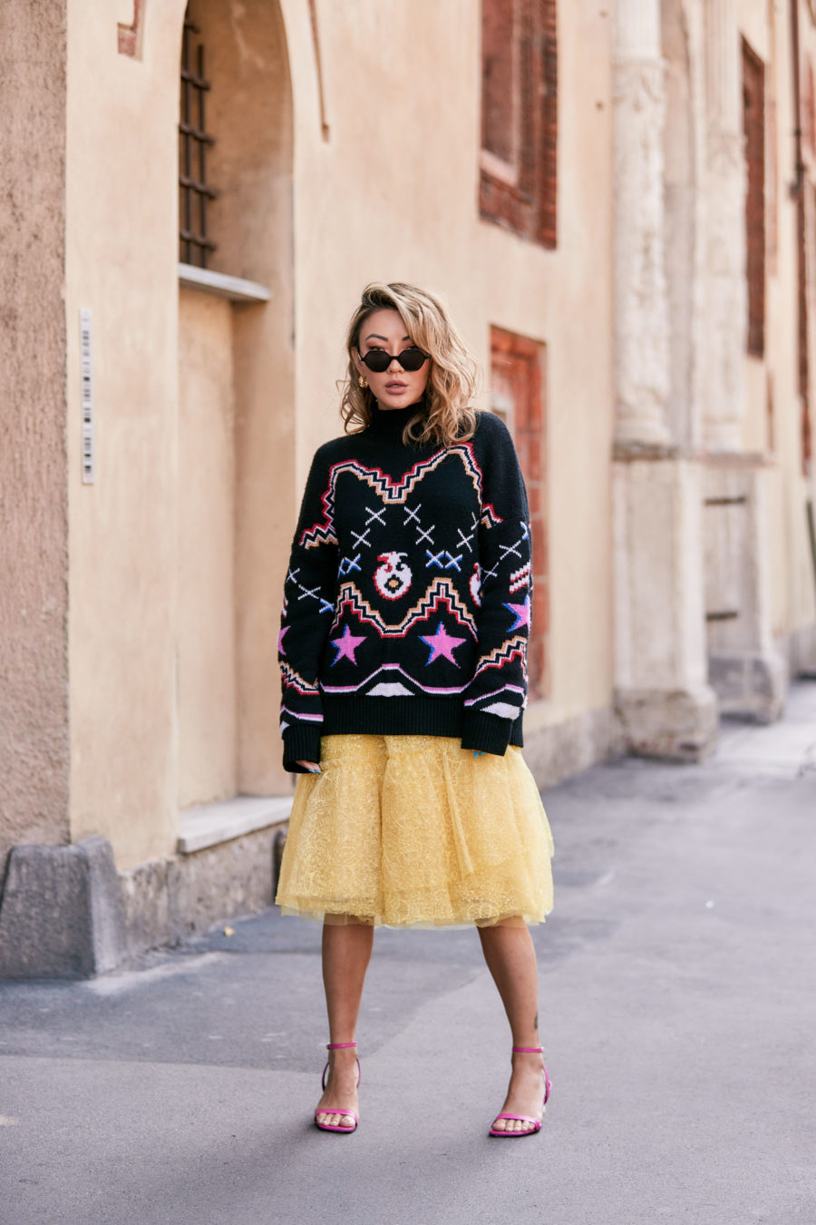 fashion blogger jessica wang shares thanksgiving day outfit ideas and wears a tulle skirt with a large graphic sweater // Notjessfashion.com
