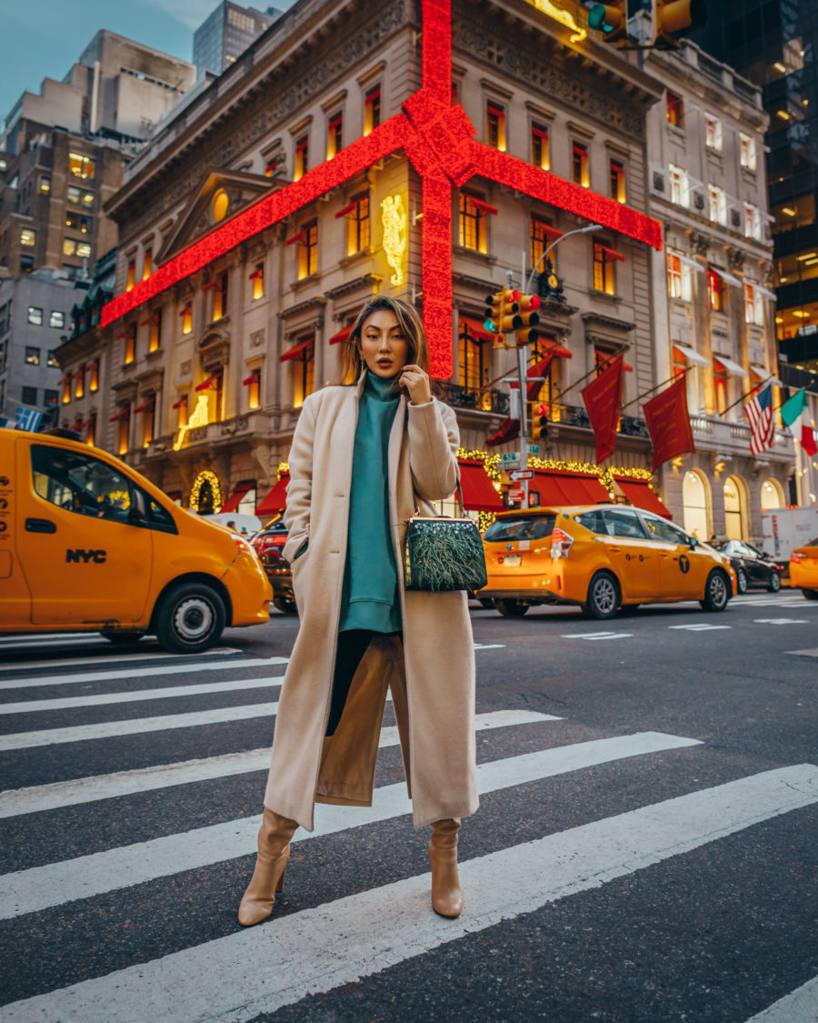 fashion blogger jessica wangs shares holiday gifts that give back and wears camel coat with green tunic and knee high boots // Notjessfashion.com