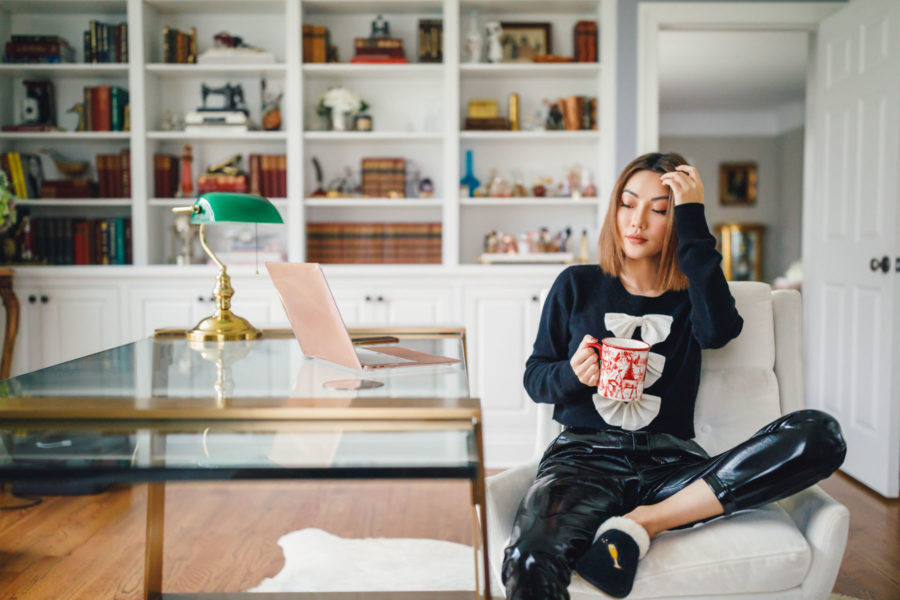 fashion blogger jessica wang wears bow tie sweater and patent leather joggers sharing tips to stay safe online shopping // Notjessfashion.com
