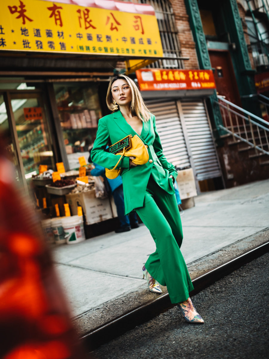 fashion blogger jessica wang shares holiday outfit ideas wearing green laveer suit and metallic booties // Notjessfashion.com