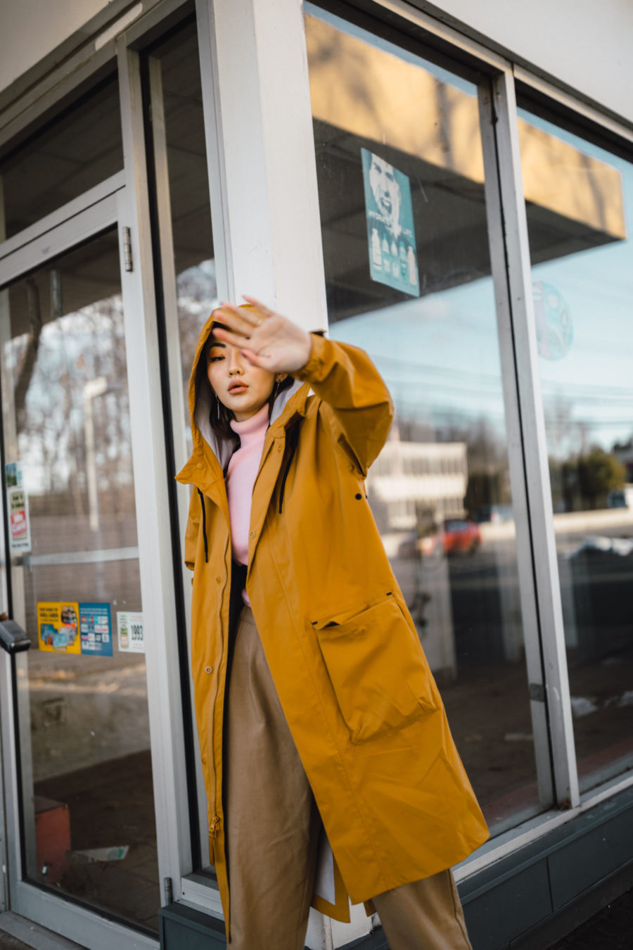 fashion blogger jessica wang wears Nike Parka with turtleneck top trousers and embellished heels // Notjessfashion.com
