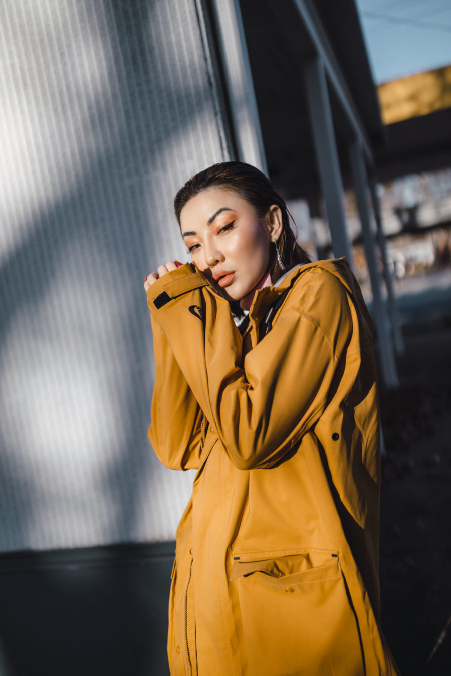fashion blogger jessica wang dresses up a Nike Parka with turtleneck top trousers and embellished heels // Notjessfashion.com